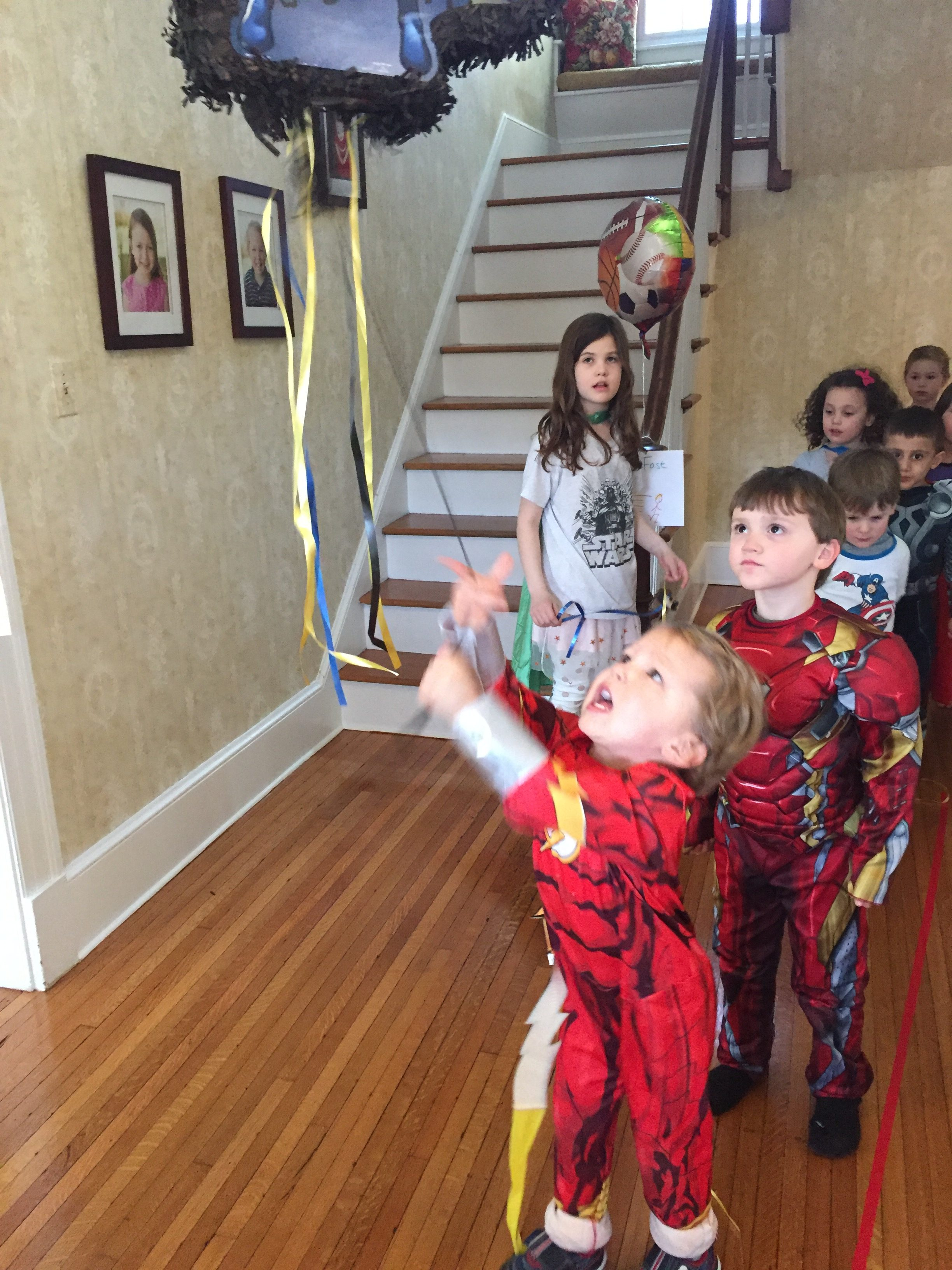 Look at those muscles pull the cord on the pinata! (The safer 2017 version of a pinata - no wooden bat)